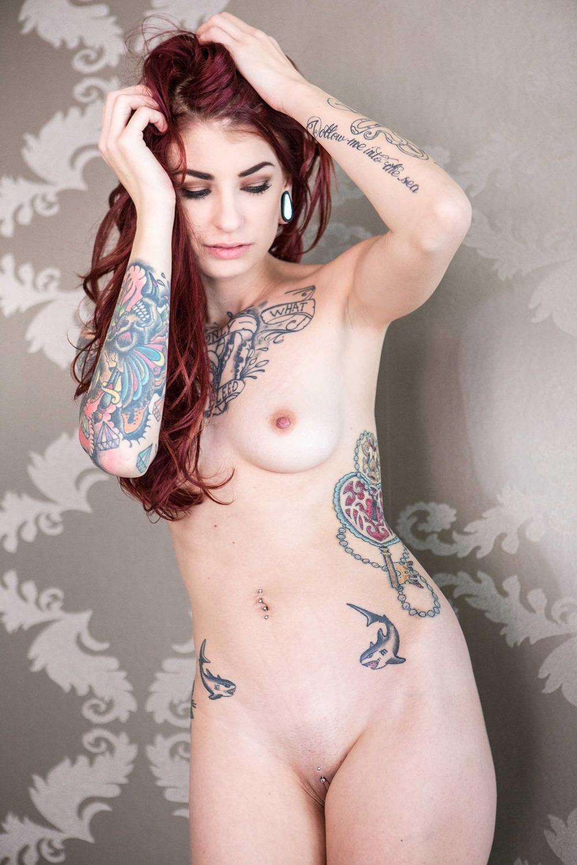 Pale naked tattoo girl, dildo position